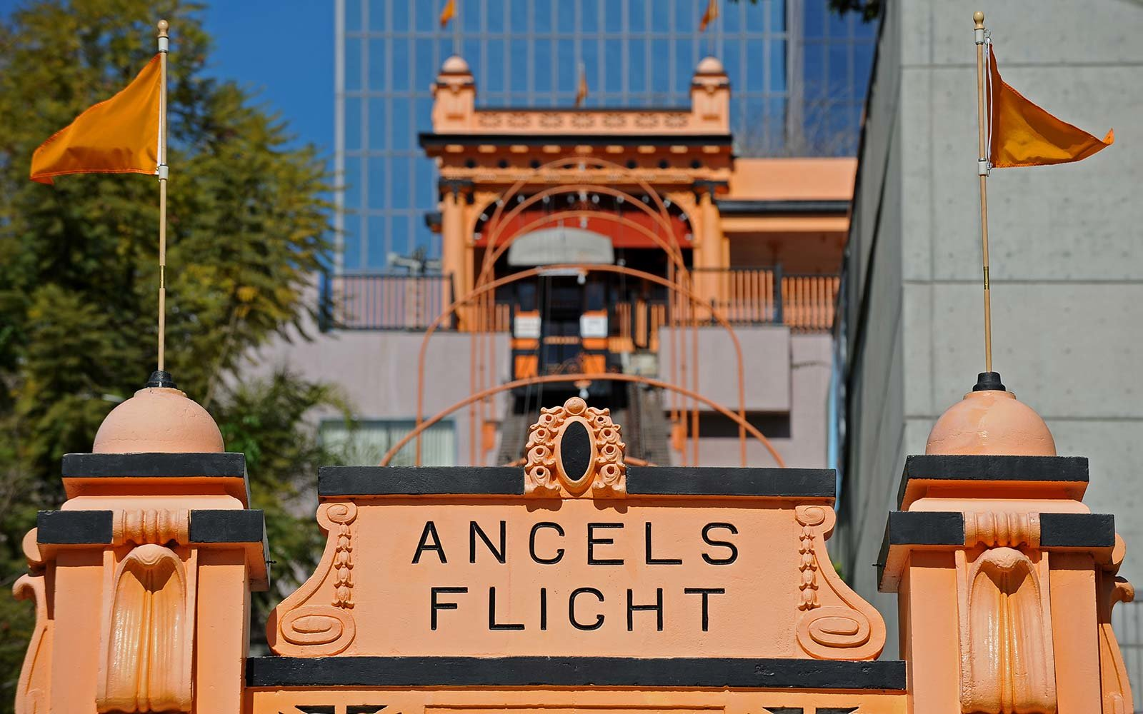 "The Angels Flight Railway, for the first time in more than nine years, resumes ferrying passengers up and down Bunker Hill in downtown Los Angeles Angel's Flight, which has been dubbed ""the shortest railway in the world,"""