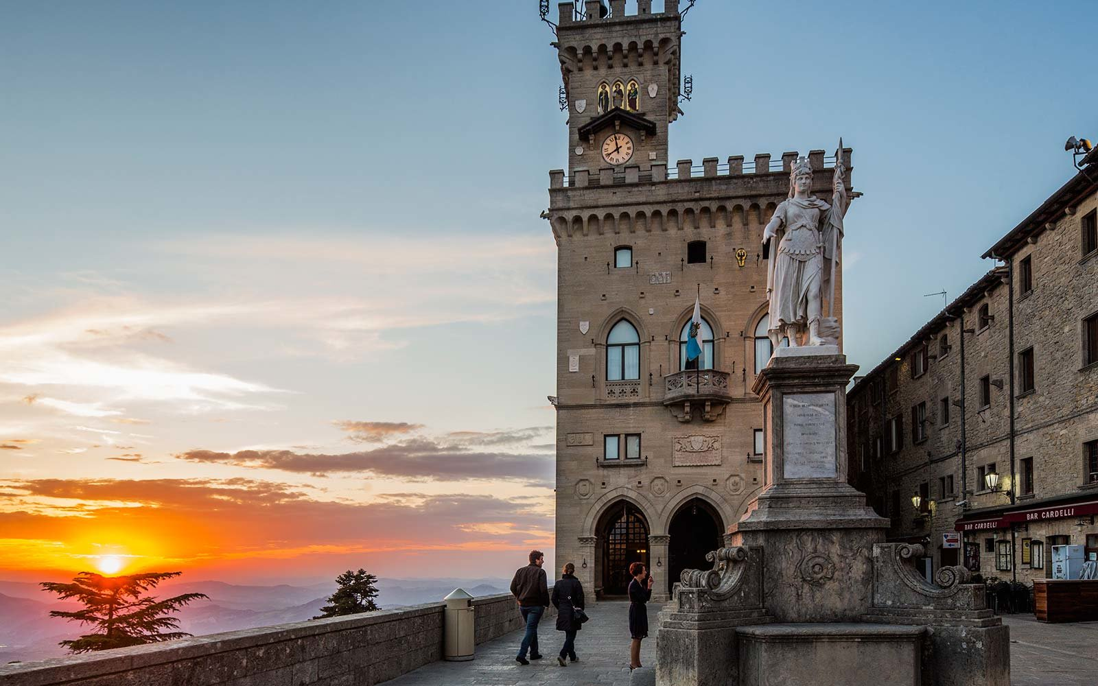 Palazzo Pubblico (Public Palace, Town Hall) and the  Statua della Libertà (Statue of Liberty) by Stefano Galletti (1876) at sunset San Marino