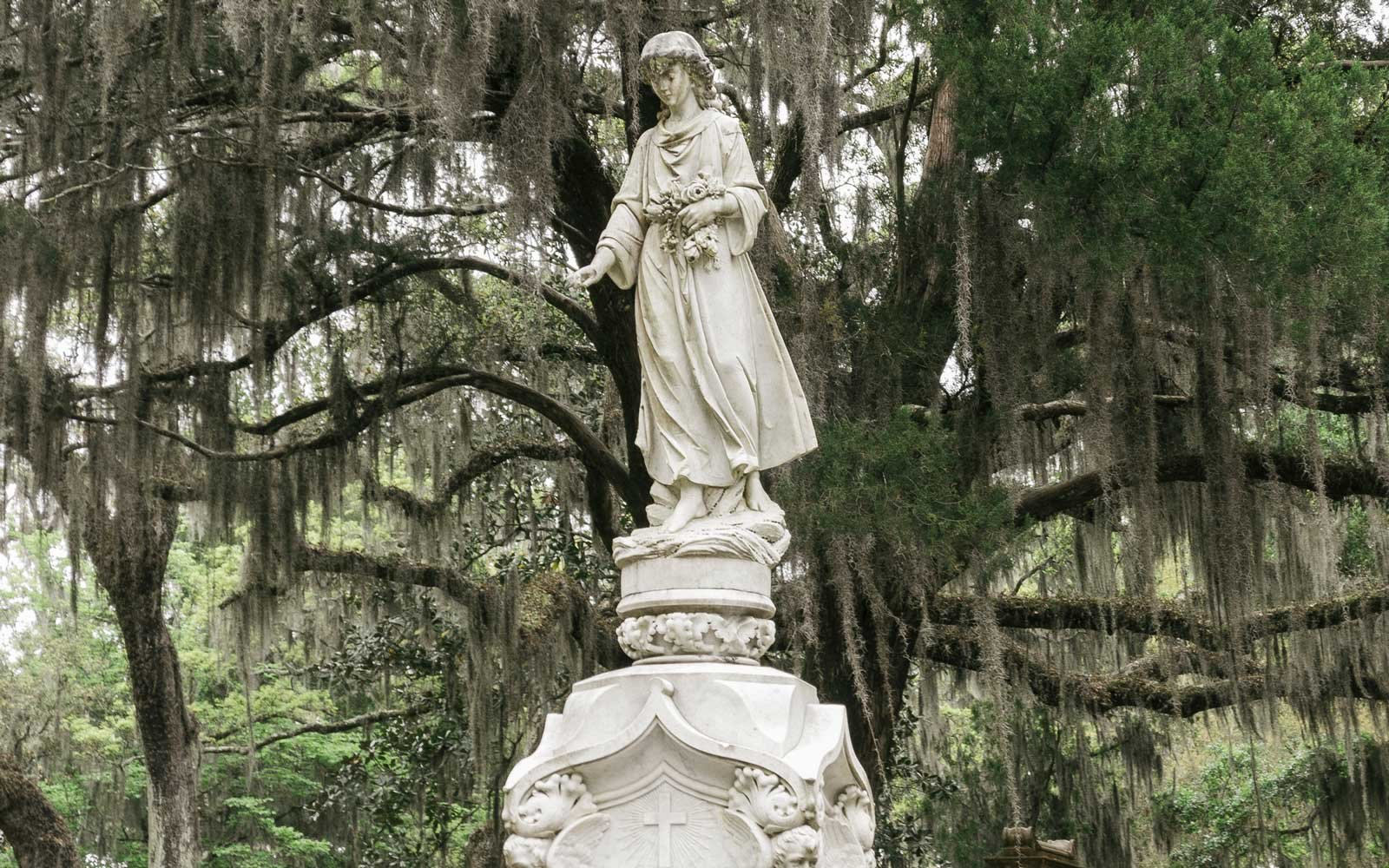 Angel statue and monument in Bonaventure Cemetery in Savannah, Georgia.