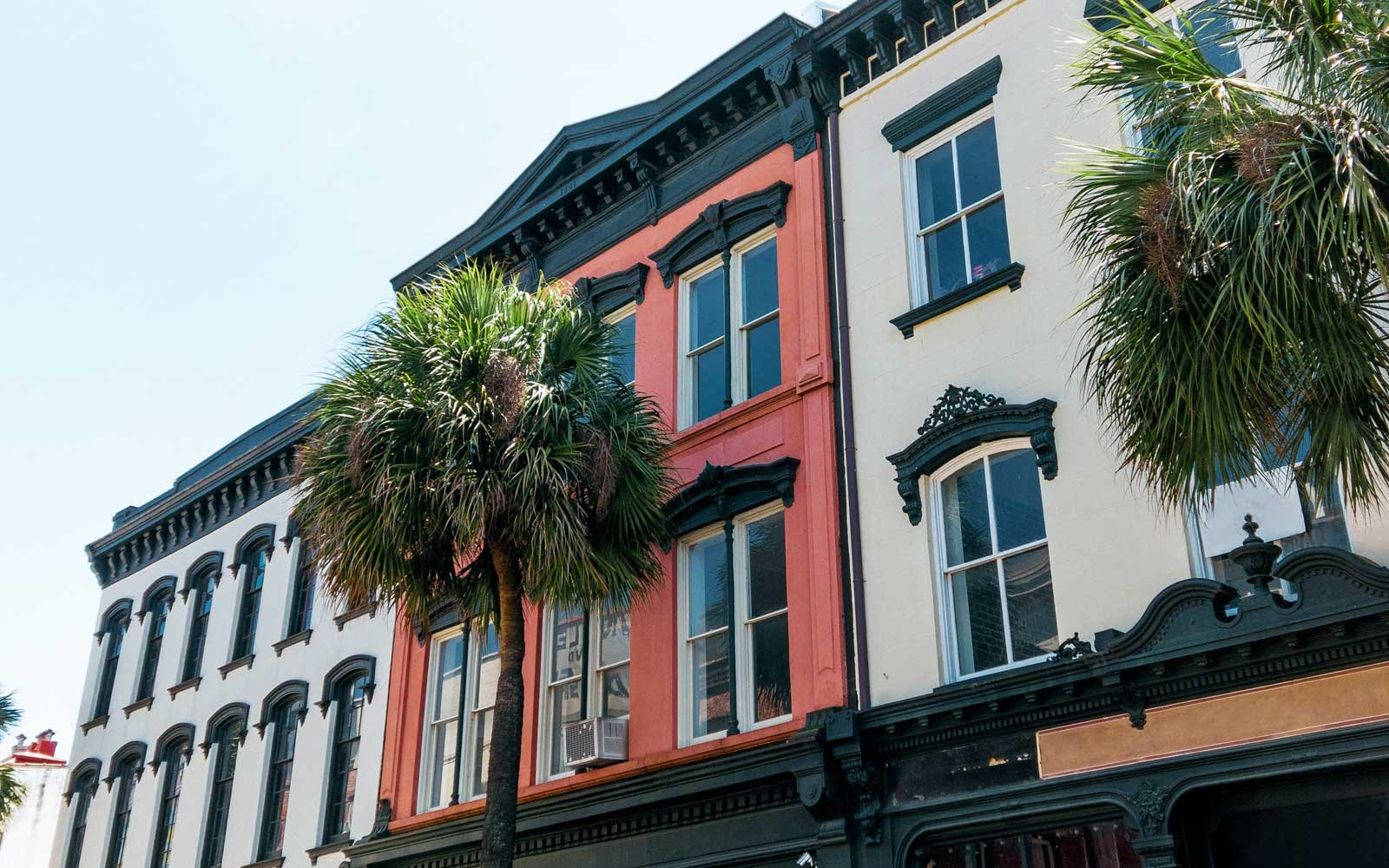 Typical architecture of downtown Savannah, GA with palm trees.
