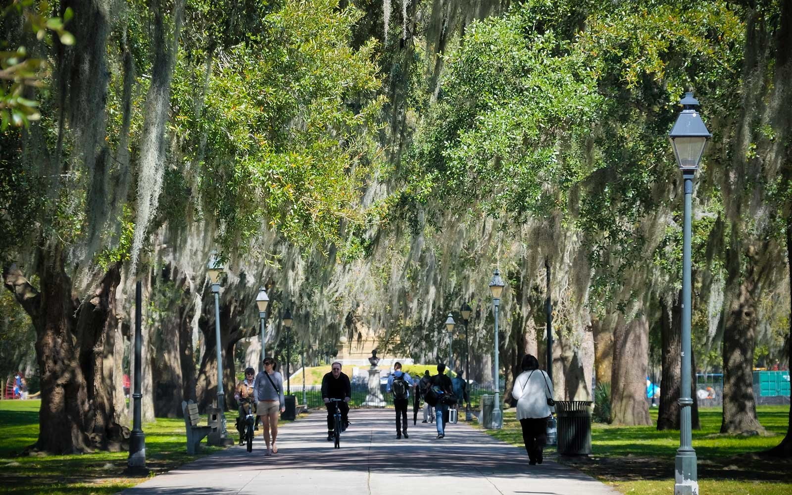 People walking in Forsythe Park, one of the many city parks in Savannah.