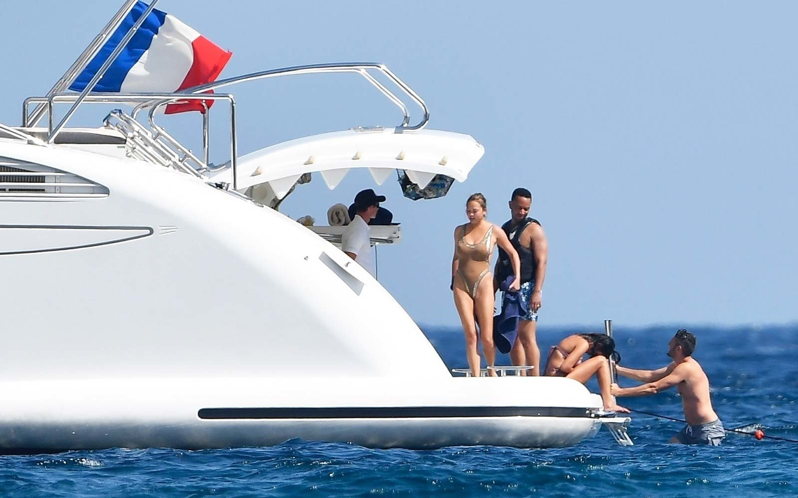 Model Chrissy Teigen and her hubby John Legend were seen enjoying a day in the sun on a yacht in Corsica, France