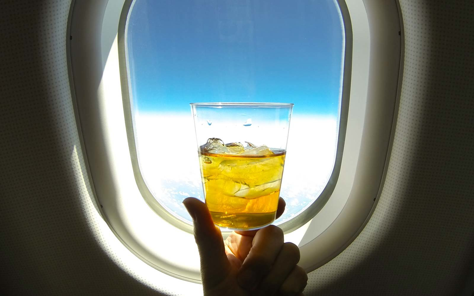 Alcohol Liquor Whiskey Airplane cabin window drunk passenger