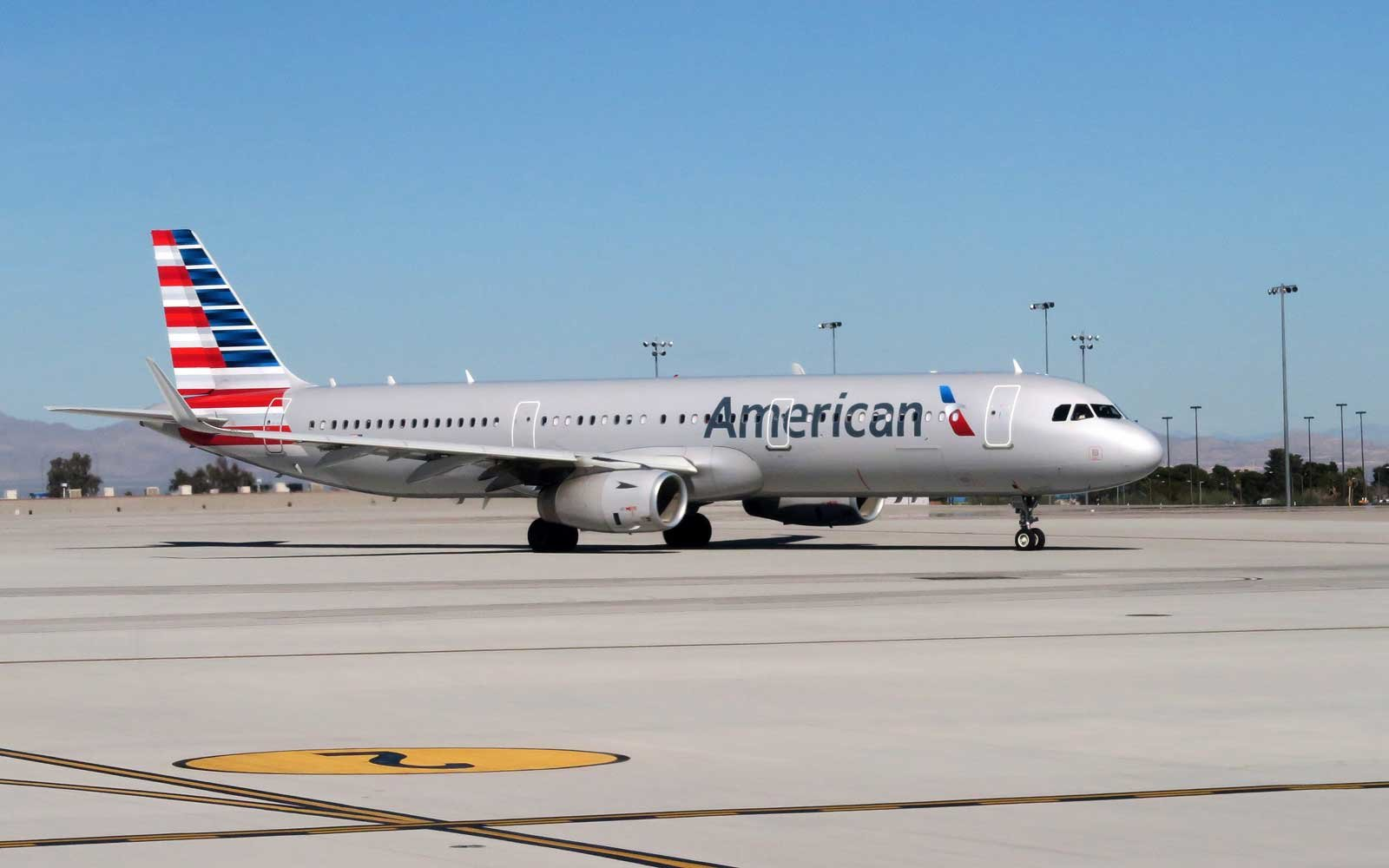 An American Airlines plane sits on the tarmac of McCarran International Airport in Las Vegas, Nevada