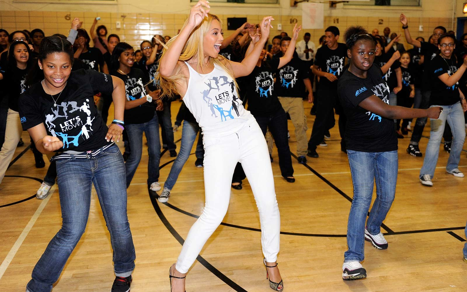 "Beyonce surprises students at PS/MS 161 in Harlem as part of First Lady Michelle Obama's ""Let's Move"" initiative to fight childhood obesity. The students were dancing to ""Move Your Body,"""