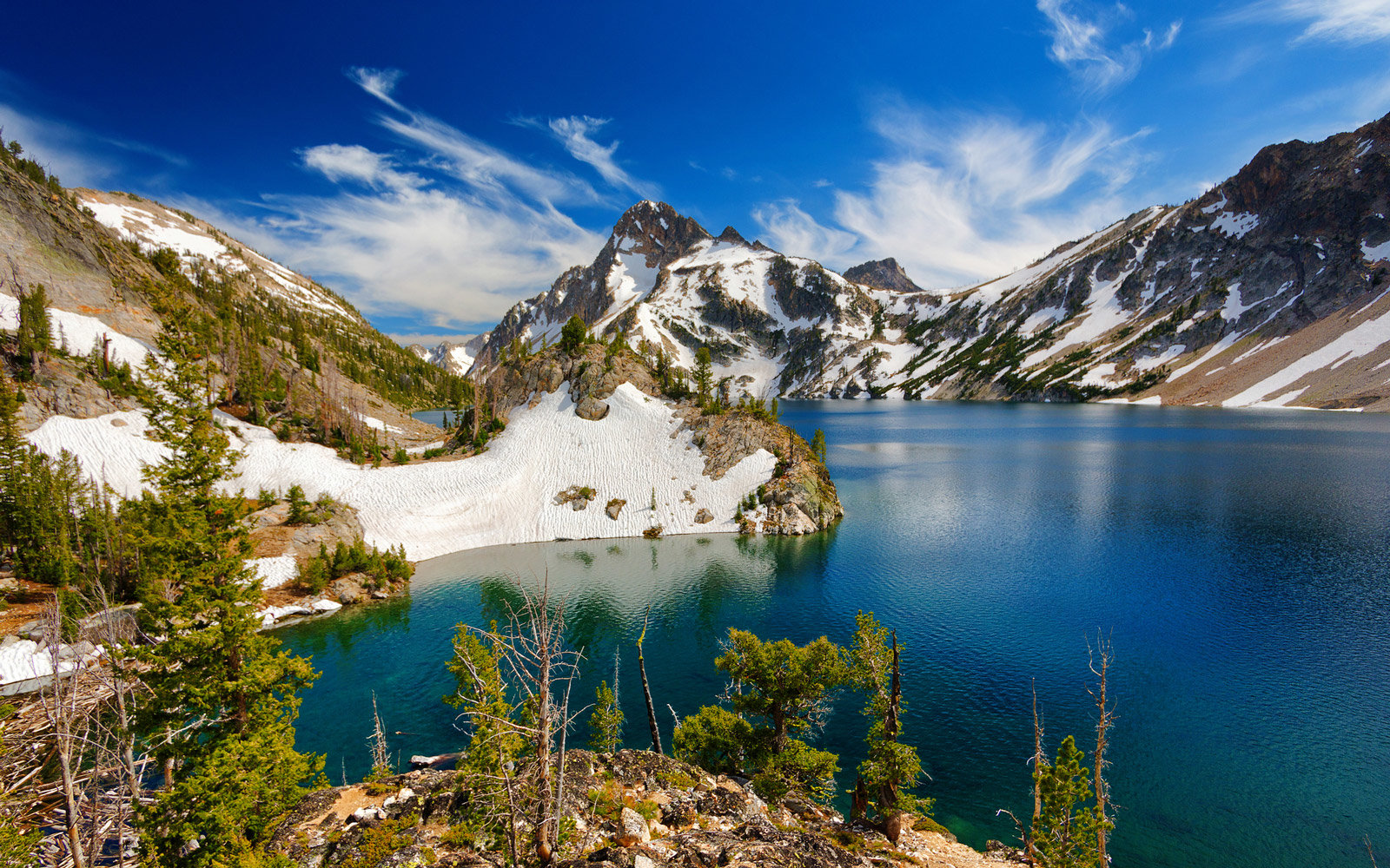 Sawtooth Lake on partly cloudy afternoon in Sawtooth Wilderness outside Stanley, Idaho.  The lake is a popular 10-mile round-trip hike and often snow-covered well into summer.