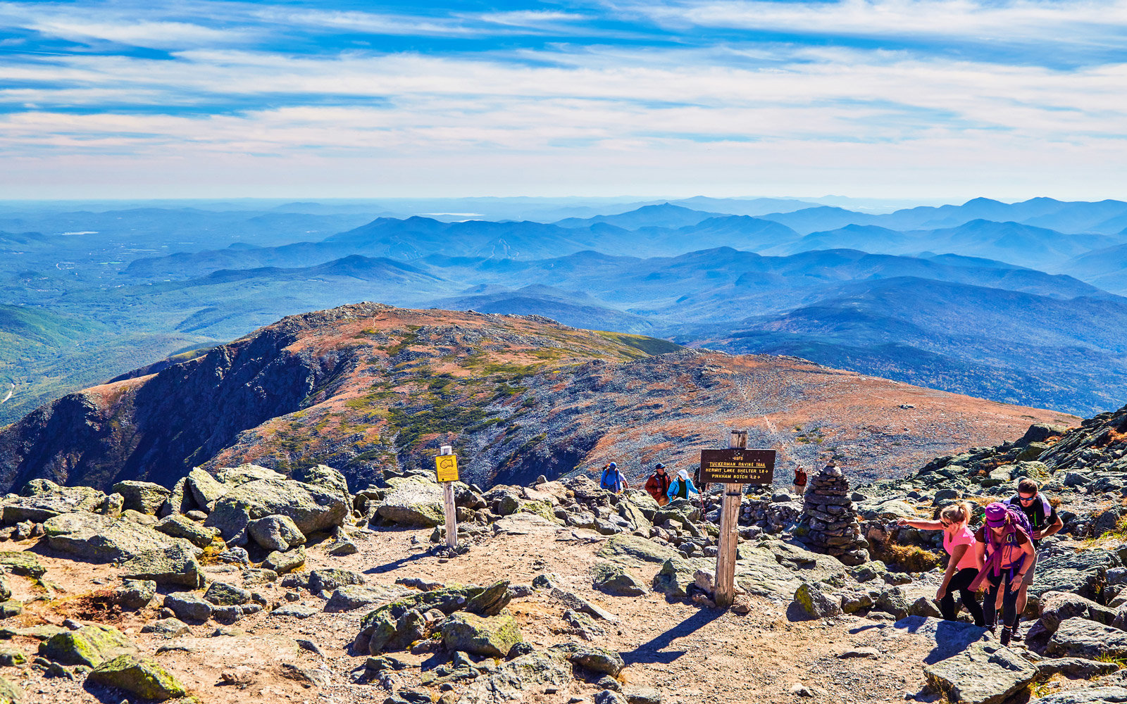 Hikers reaching the summit of Mt Washington after climbing the trail up the mountain side,Mt Washington,New Hampshire,USA