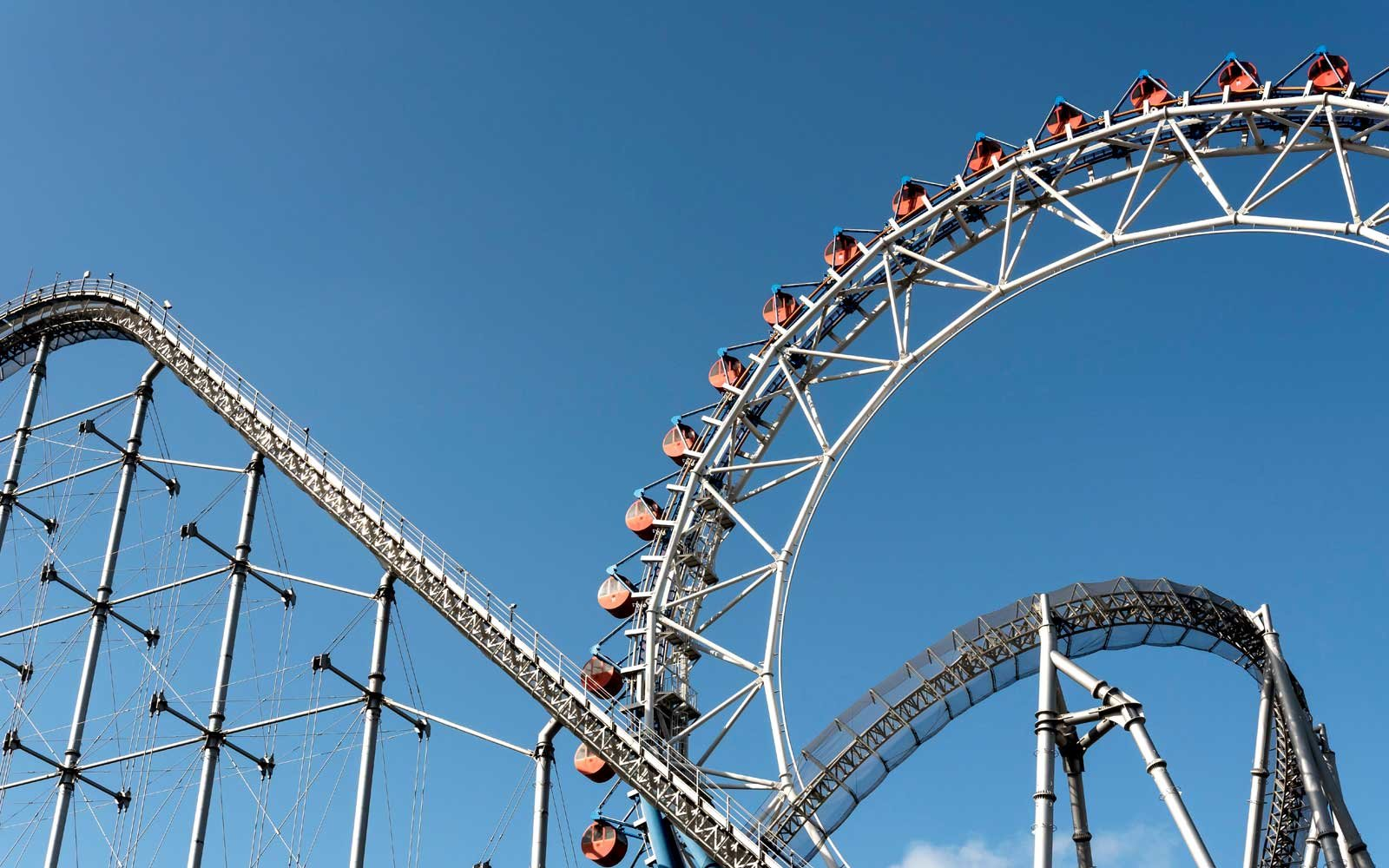 Roller coaster and Ferris wheel, Tokyo Dome City Attractions amusement park, Japan.