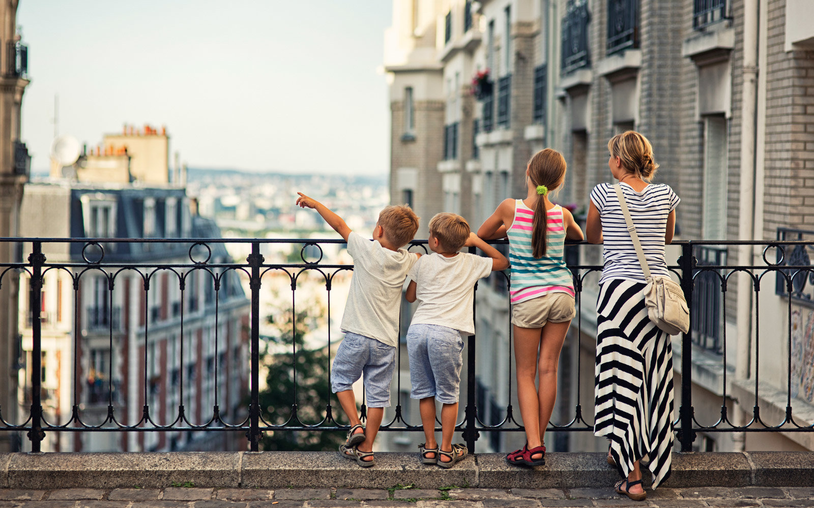 Mother and children traveling through Paris, France