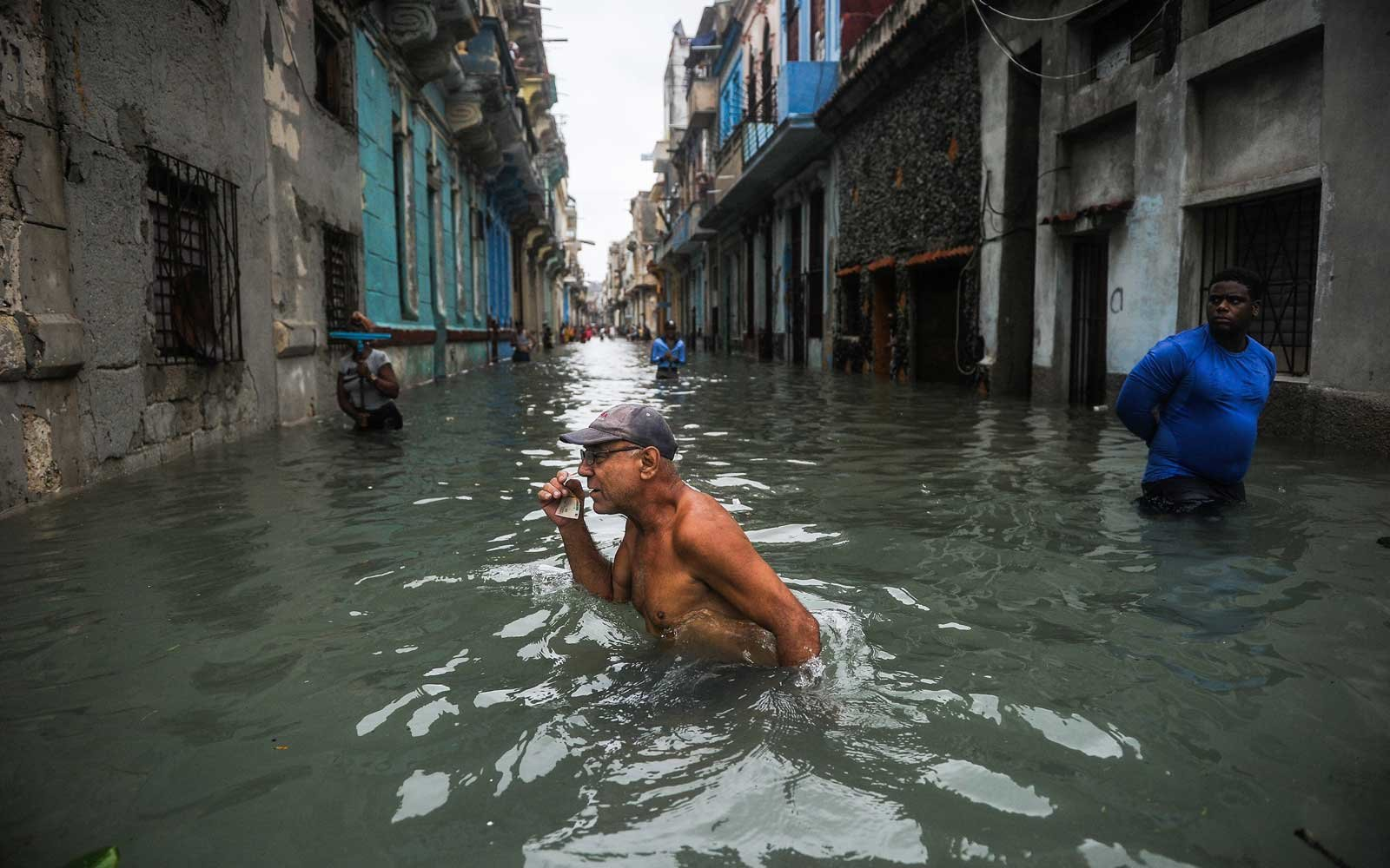 A Cuban wades through a flooded street in Havana, on September 10, 2017