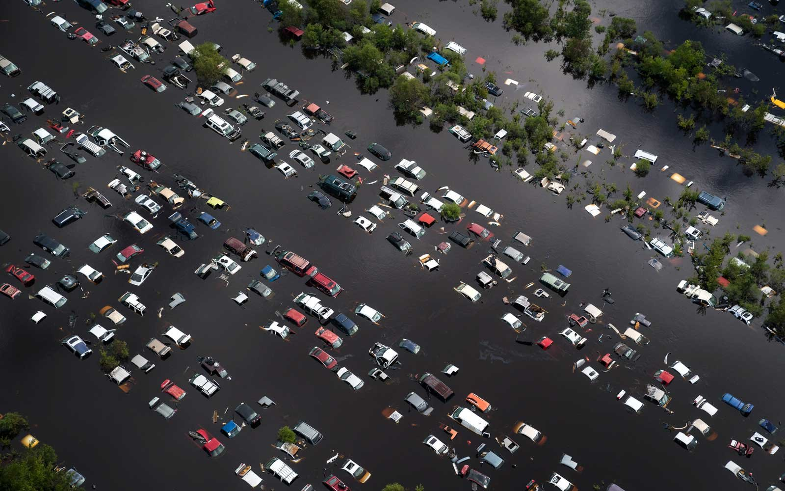A scrap yard full of vehicles is seen covered by flood water in the aftermath of Hurricane Irma in Callahan, Fla. on Tuesday, Sept 12, 2017