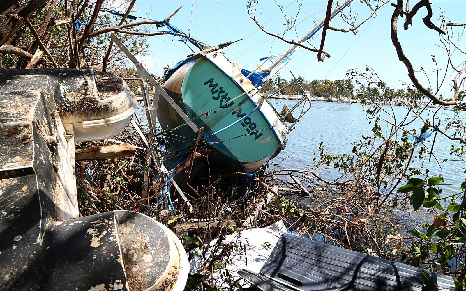A damaged sail boat washed ashore at the Grove Key Marina in Miami, after Hurricane Irma passed over South Florida, on Tuesday, Sept. 12, 2017