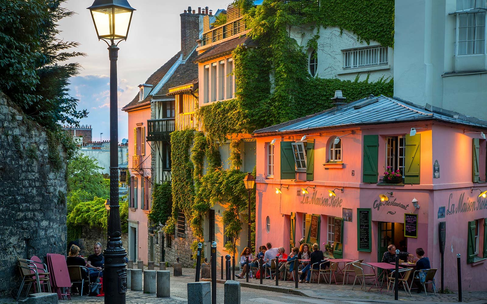 montmartre paris france neighborhood sunset romantic restaurant flight deal