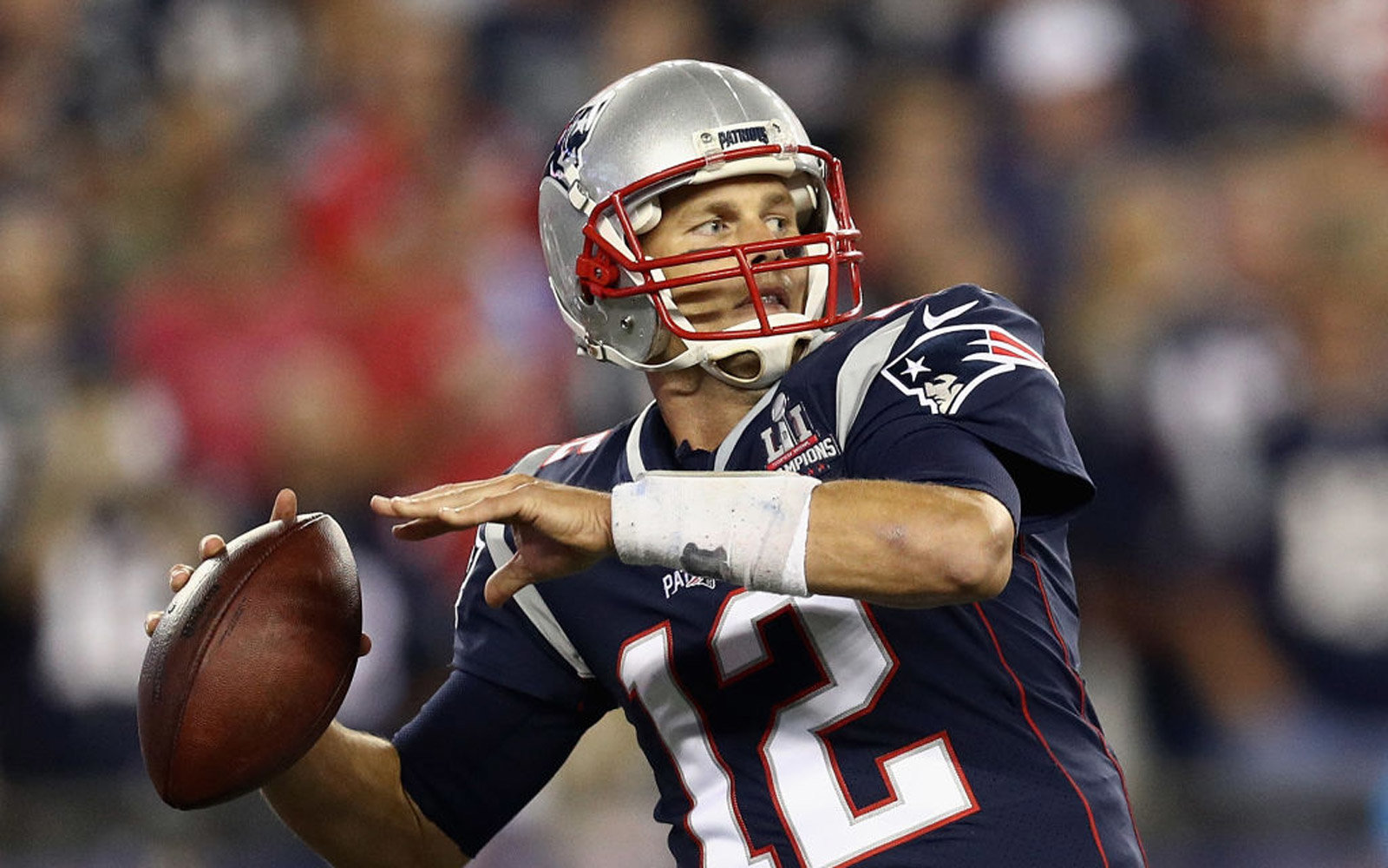 Tom Brady playing football for the Patriots