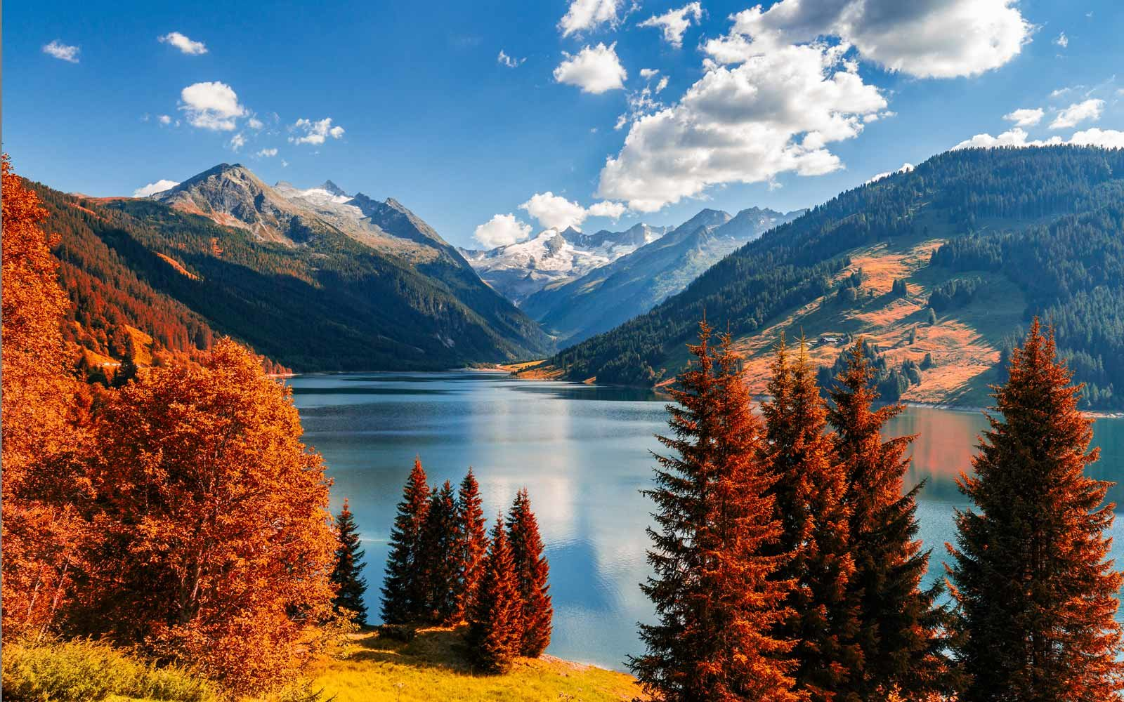 Autumn view with red foliage of Alps with lake in Tyrol, Austria