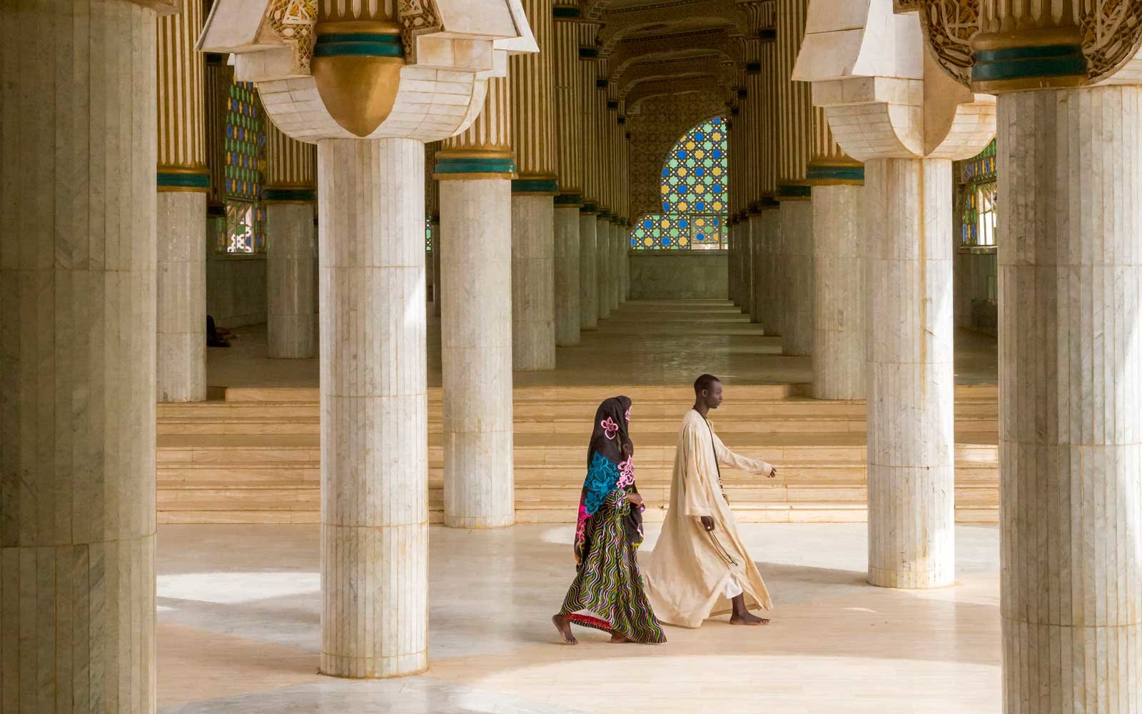Walking to prayer at the Grand Mosque in Touba, Senegal