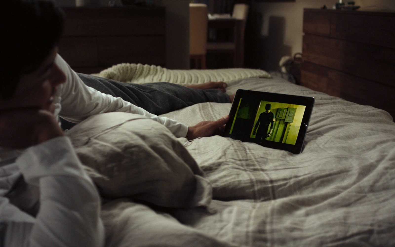 Man watching Netflix in bed