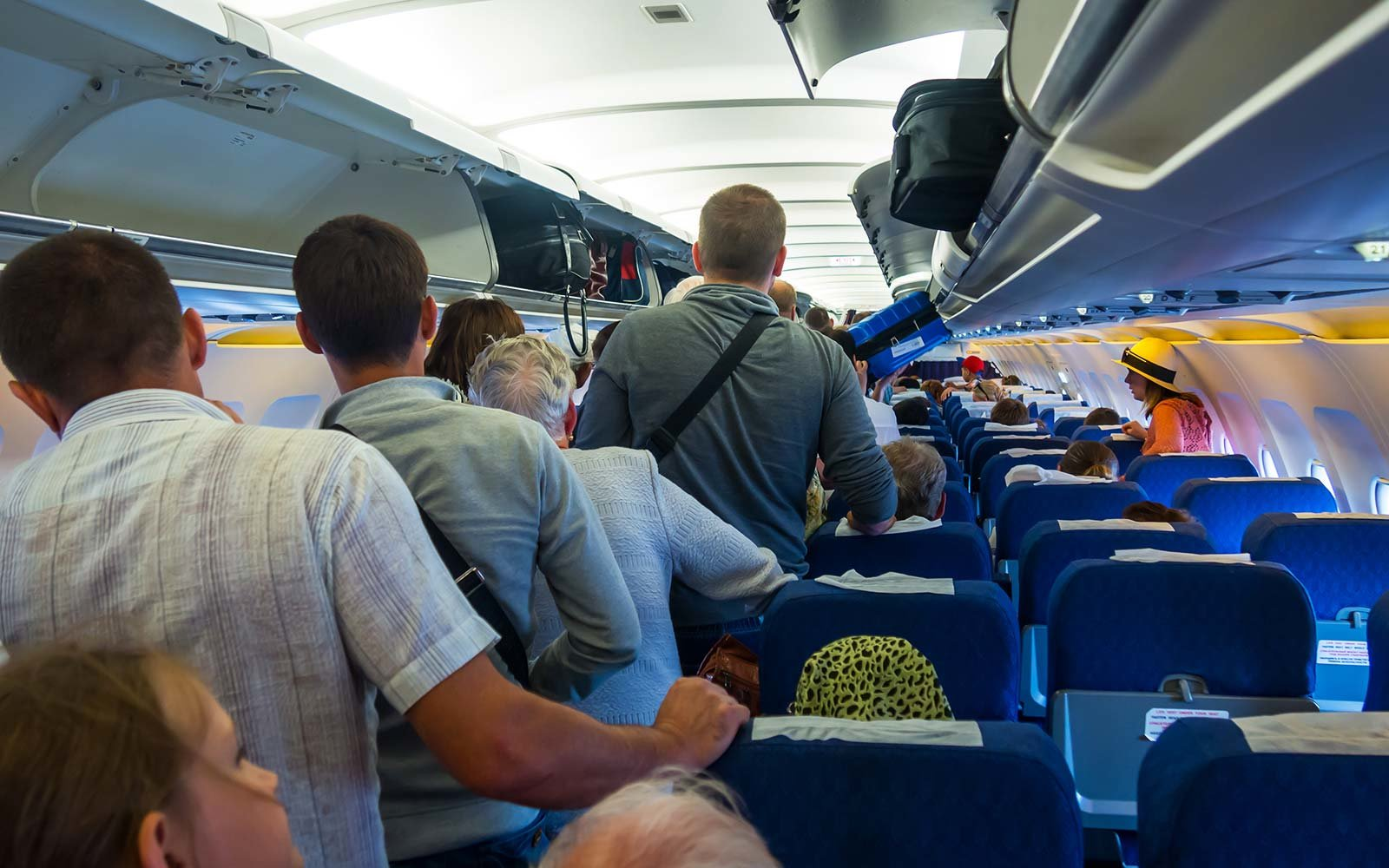 Passengers anxiously wait to disembark airplane