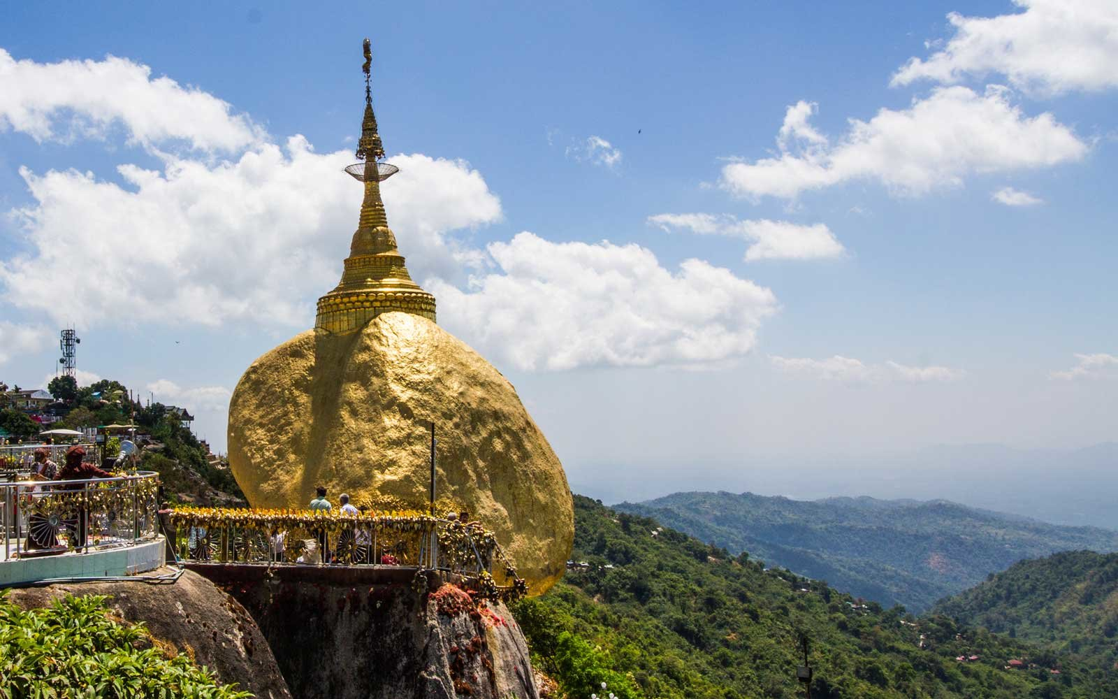 Pilgrims are praying at the Kyaiktiyo Pagoda, Golden Rock, Myanmar