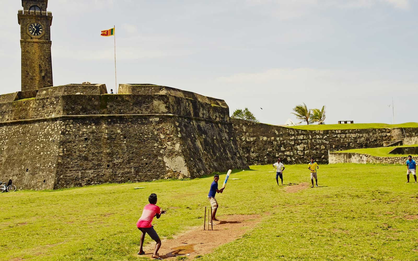 Boys play cricket at Galle Fort, in southern Sri Lanka