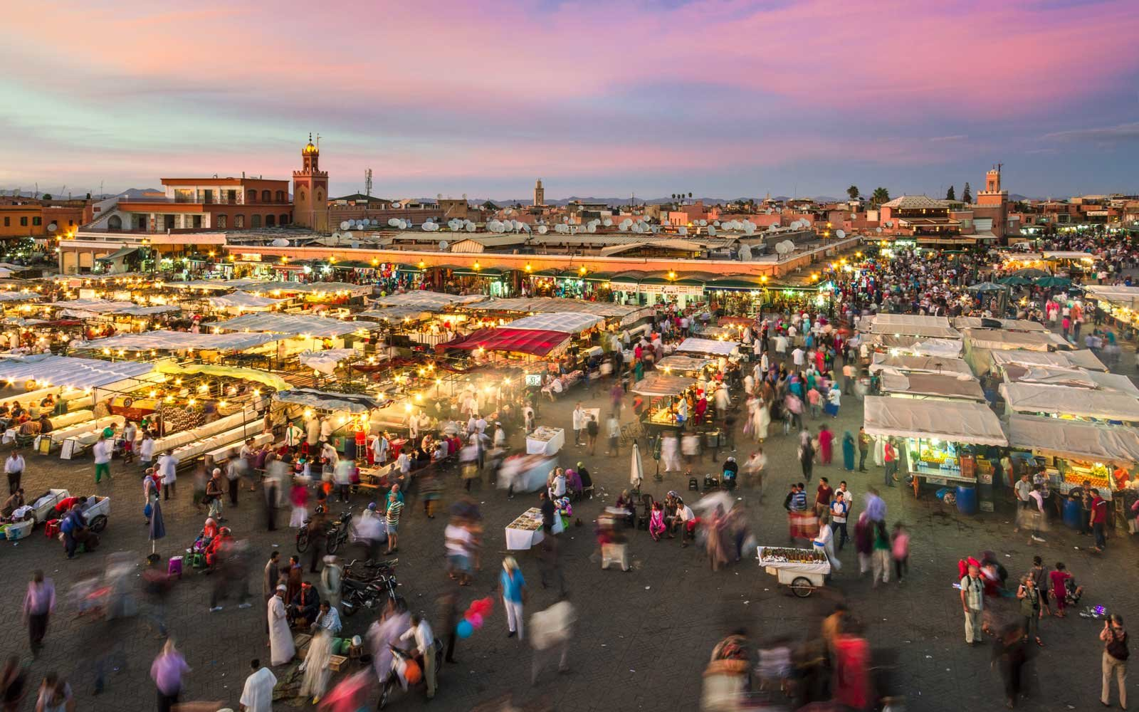 Jamaa el Fna market square in sunset, Marrakesh, Morocco