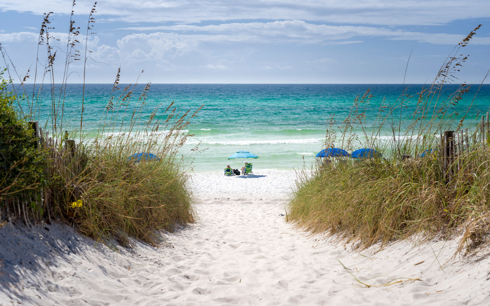 Couple enjoying the turquoise waters of Florida's Emerald Coast