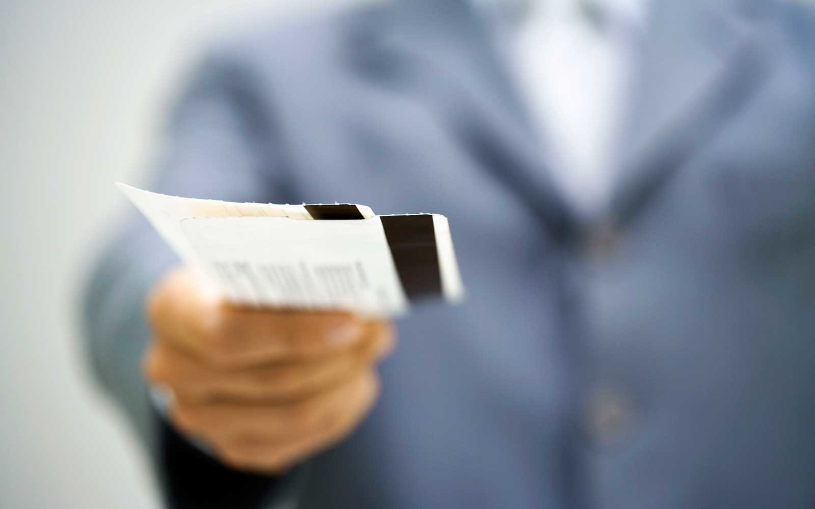 Man with airplane boarding passes