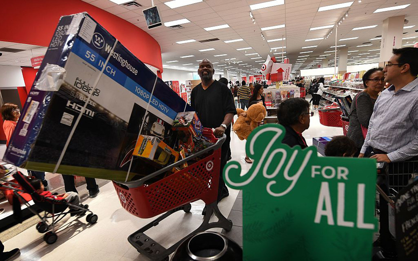 Thanksgiving Day shoppers push loaded up carts during the  Black Friday  sales at a Target store
