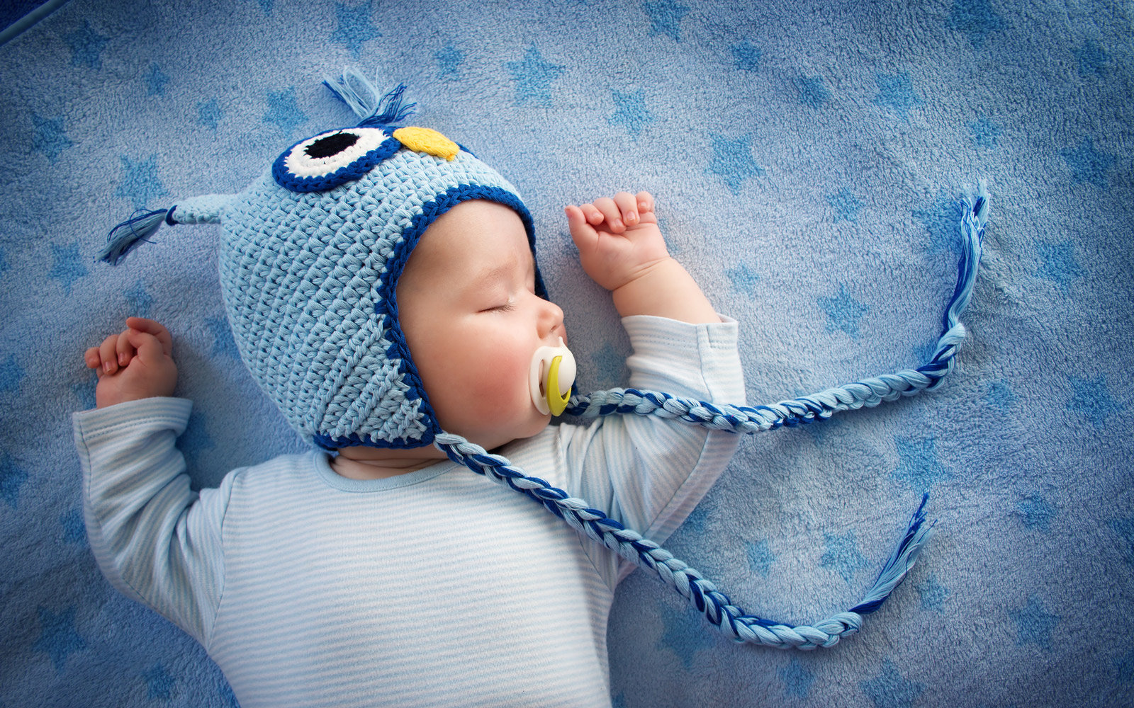 baby in owl hat sleeping