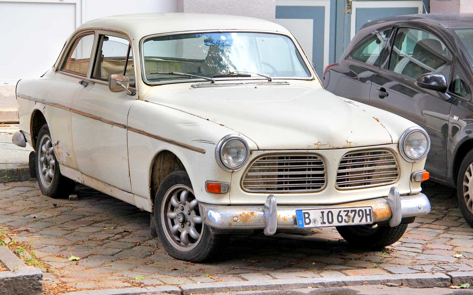 Swedish retro car Volvo Amazon parked near the museum of vintage cars Classic Remise.
