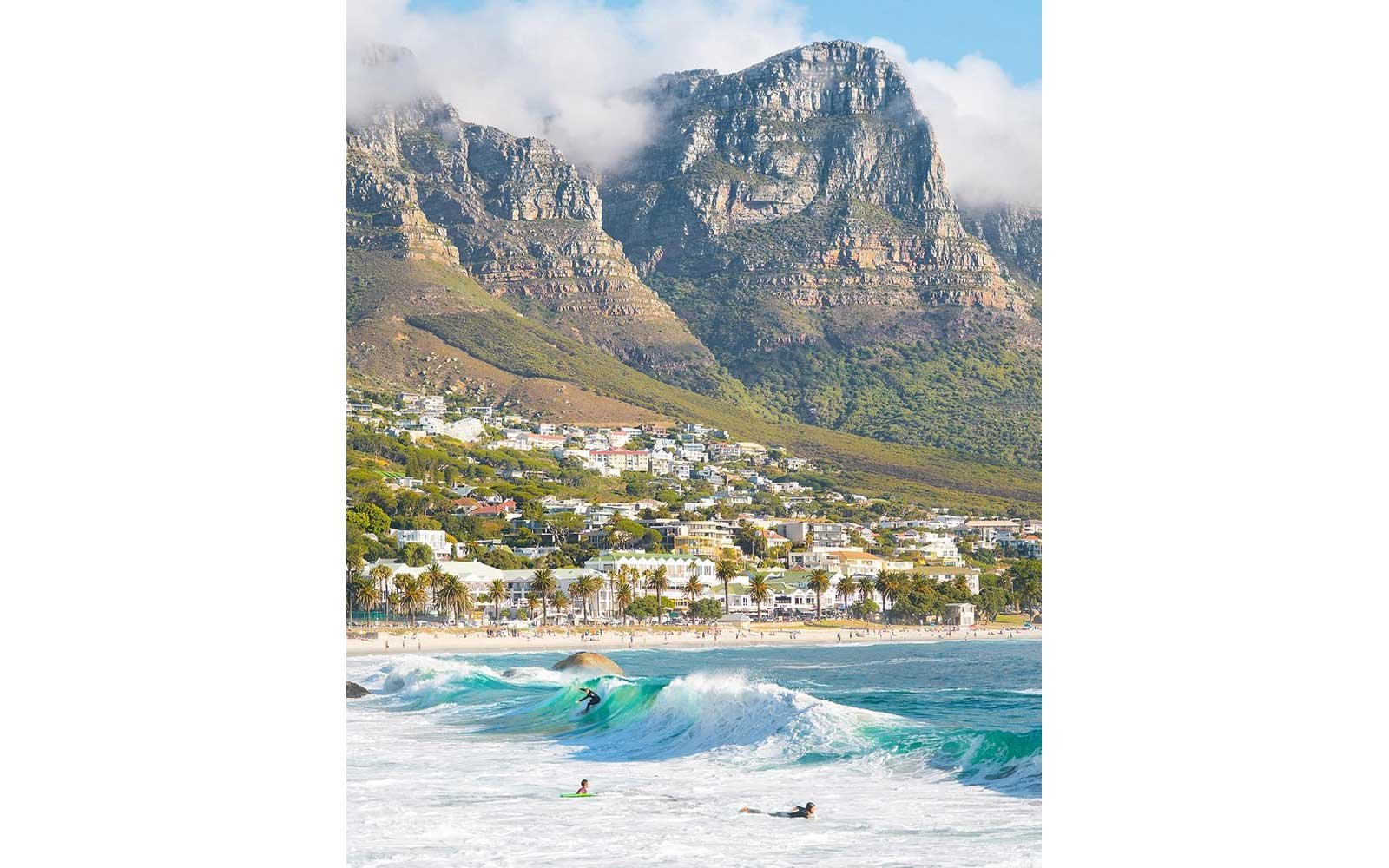 Surfers on the beach in Cape Town, South Africa