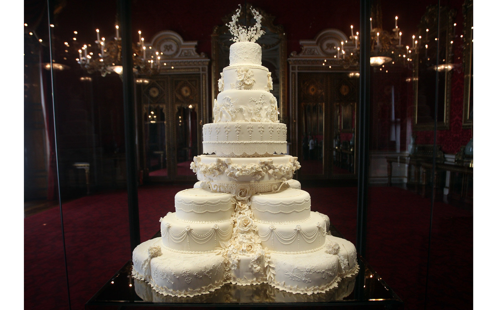 he Duke and Duchess of Cambridge's royal wedding cake is photographed before it goes on display at Buckingham Palace during the annual summer opening