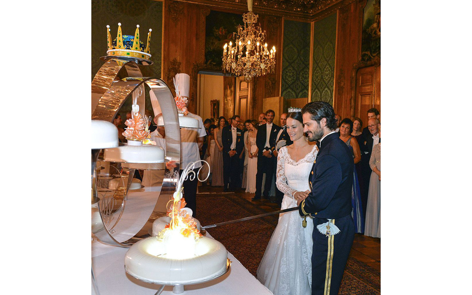 Princess Sofia and Prince Carl Philip cut the cake during their wedding at the Royal Palace in Stockholm, Sweden