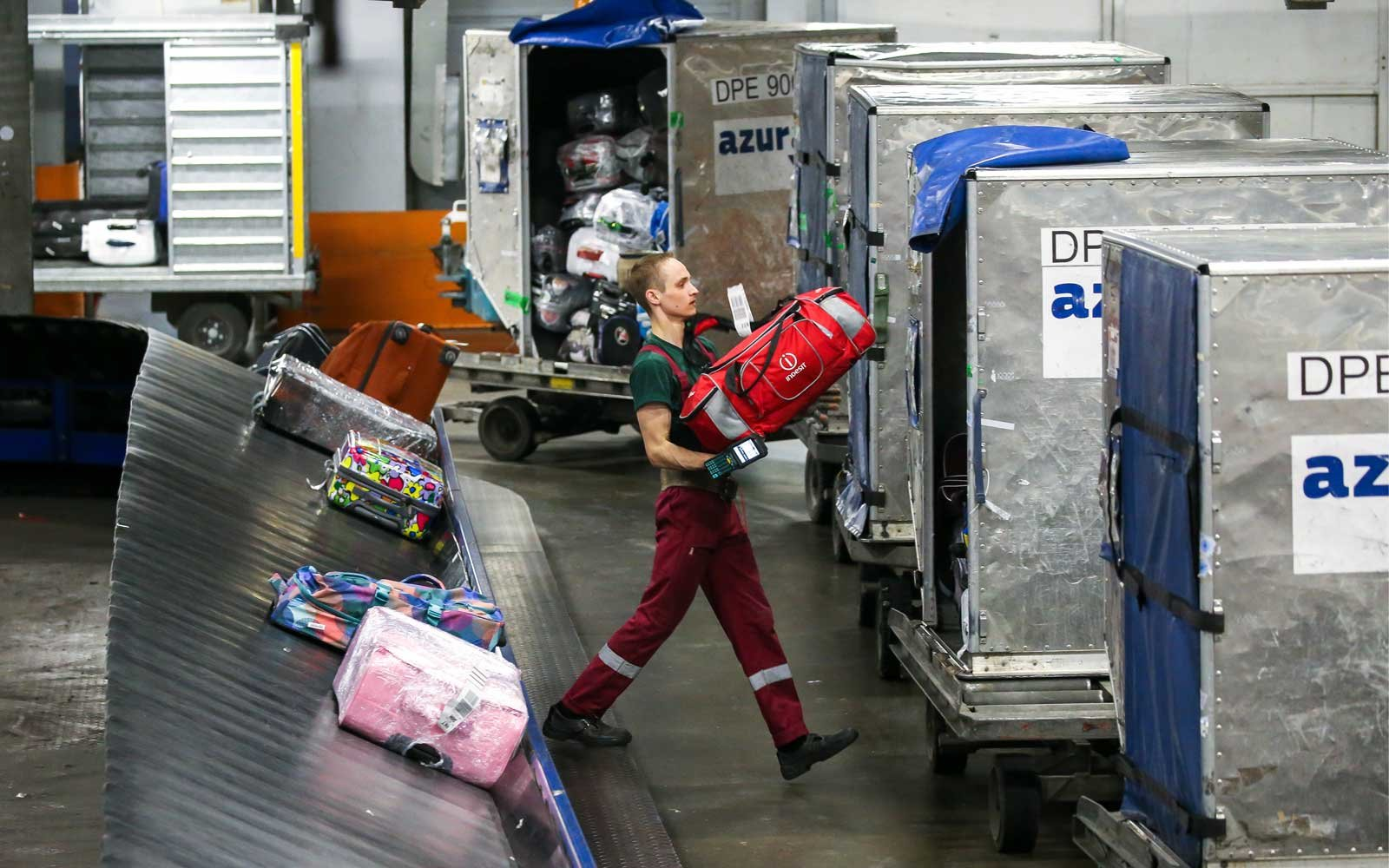 Handling baggage at Moscow's Domodedovo Airport