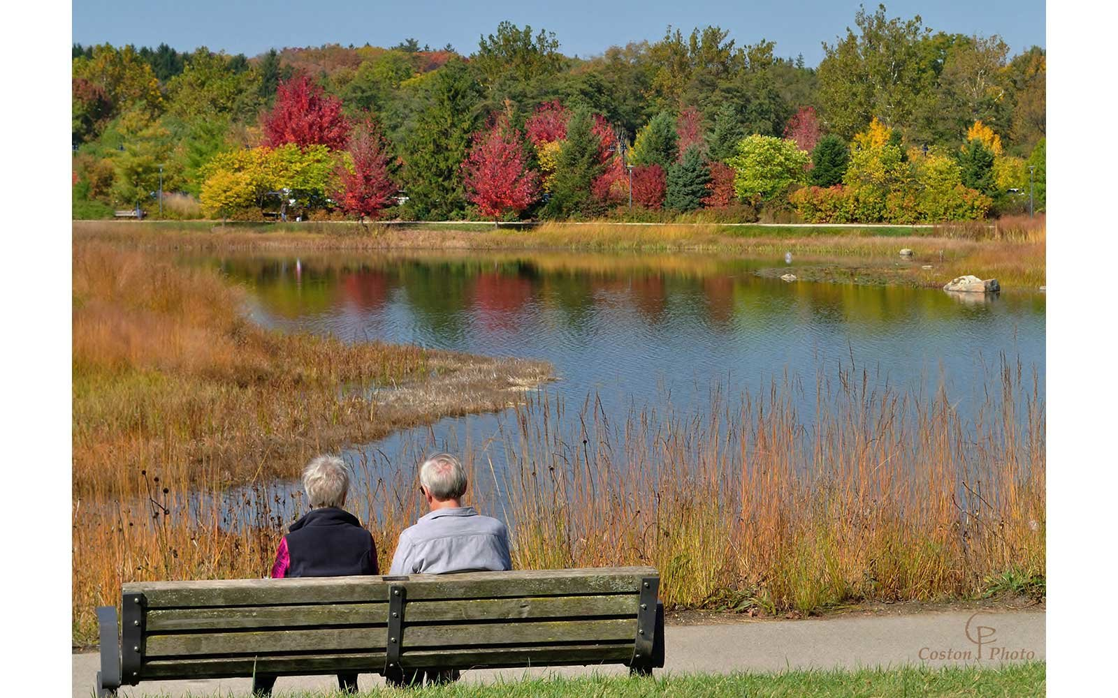 Couple by water in autumn
