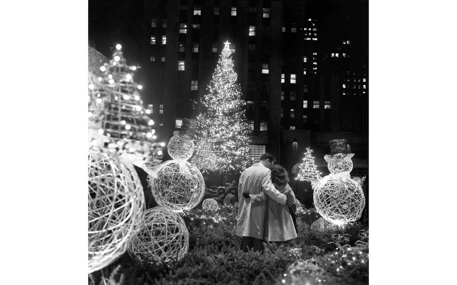 A pair of lovers are entranced by the beauty of the scene after the traditional Rockefeller Center Christmas tree was lighted.