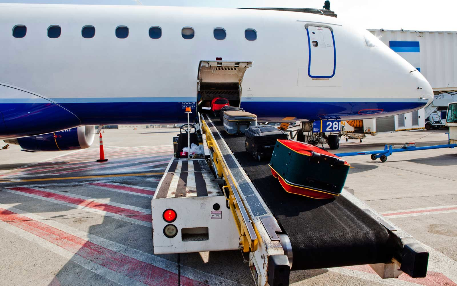 Luggage being loaded onto a commercial airplane