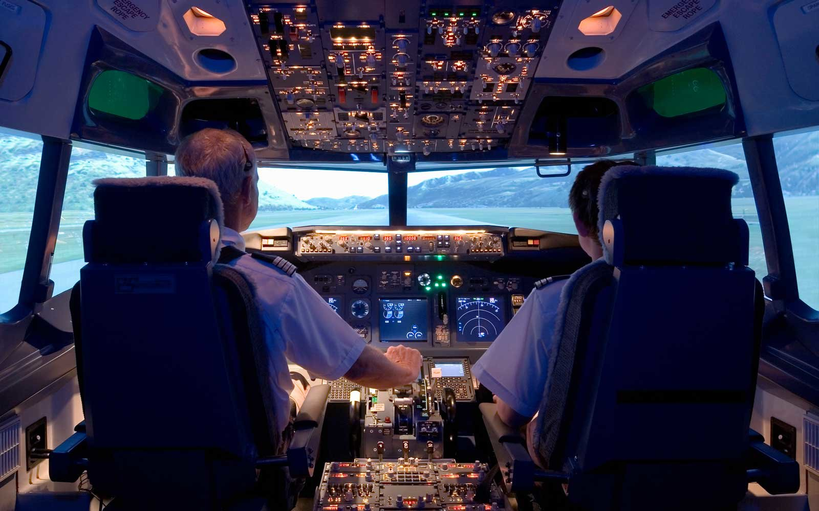 Two pilots in the cockpit of a plane