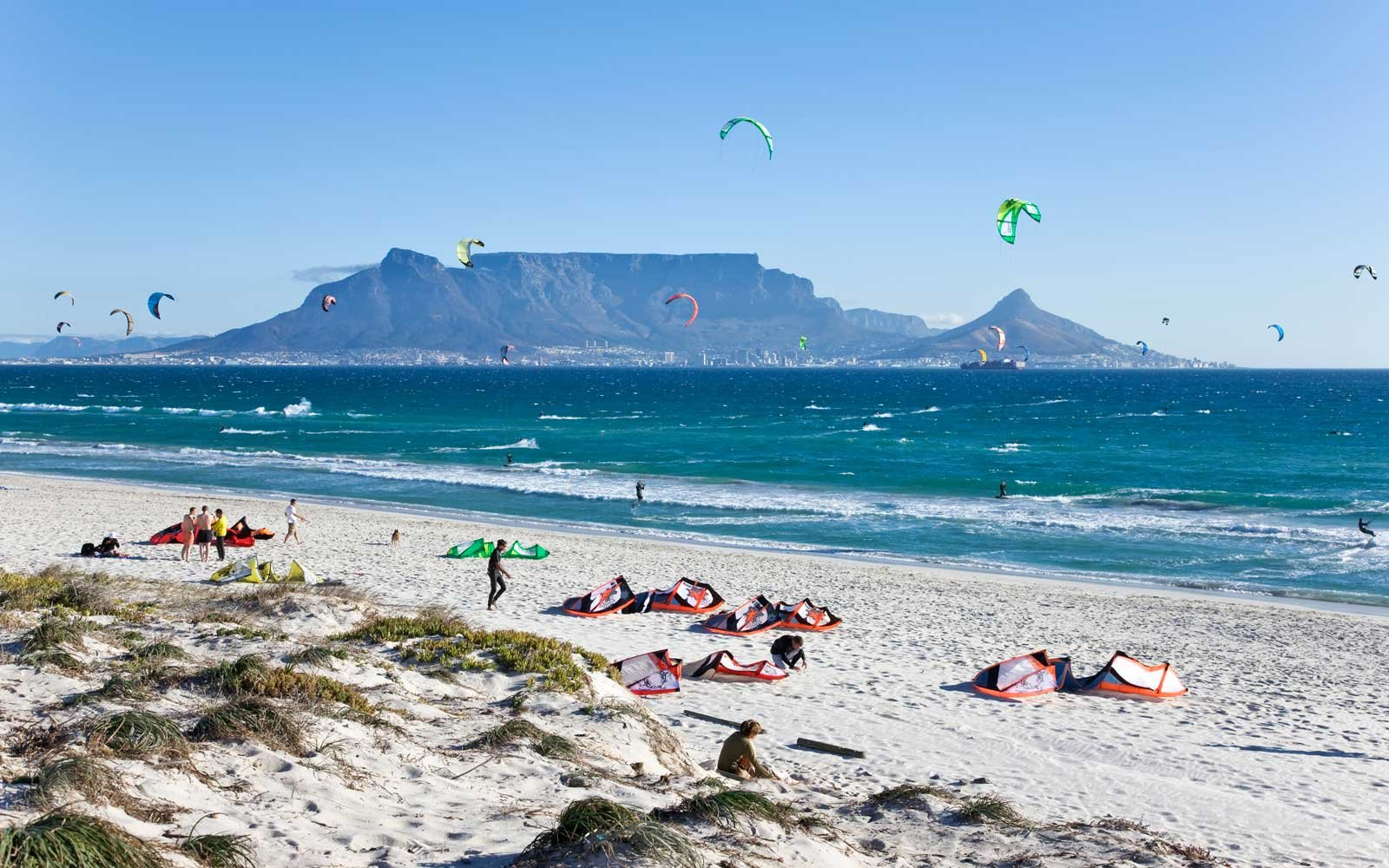 Kite surfing below Table Mountain, on Blubergstrand Beach.