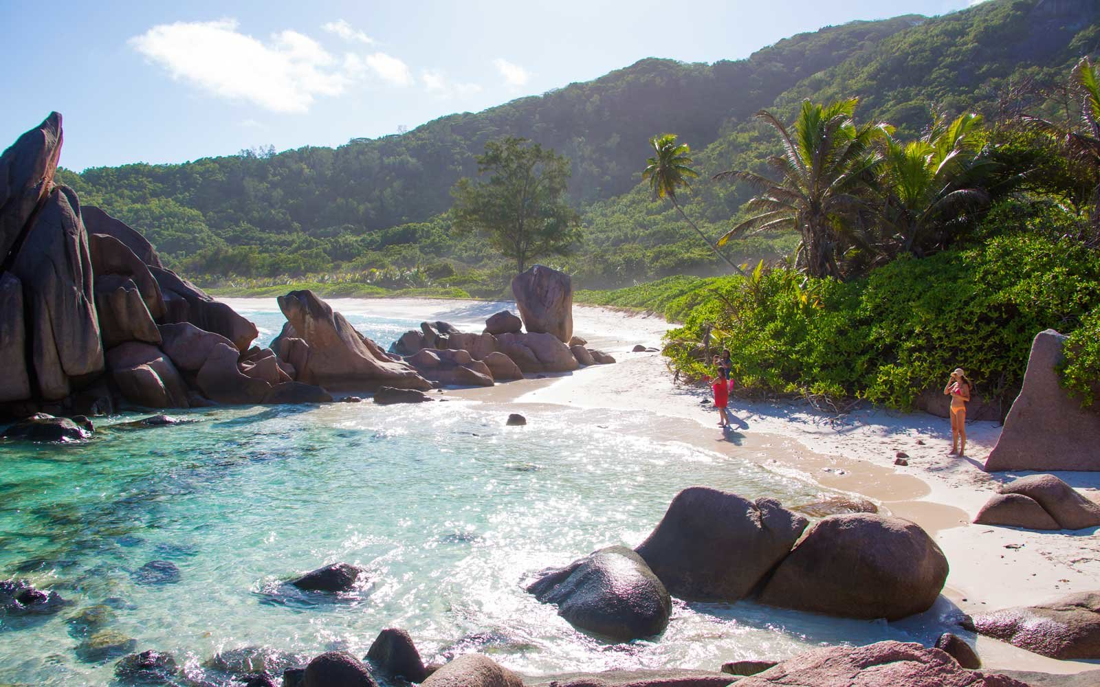 Tourists visit the famous Coco beach on October 03, 2015 in La Passe, La Digue, Seychelles.