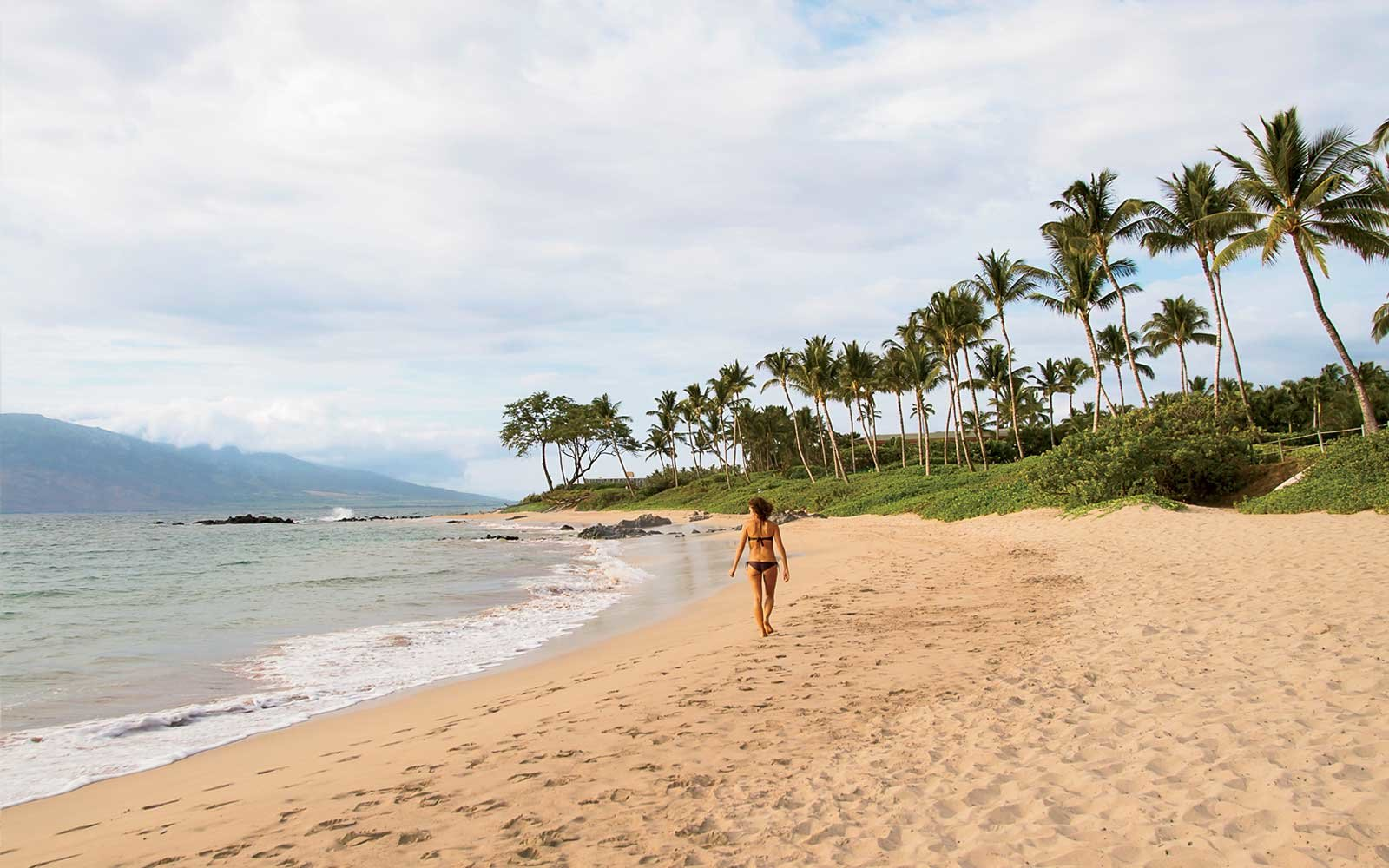 Woman on Mokapu Beach in Maui, Hawaii