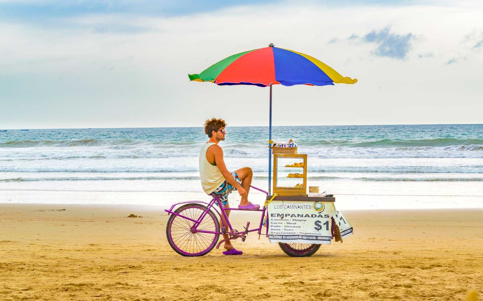 Young adult man selling food at beach in Montanita, the most famous watering place in Ecuador