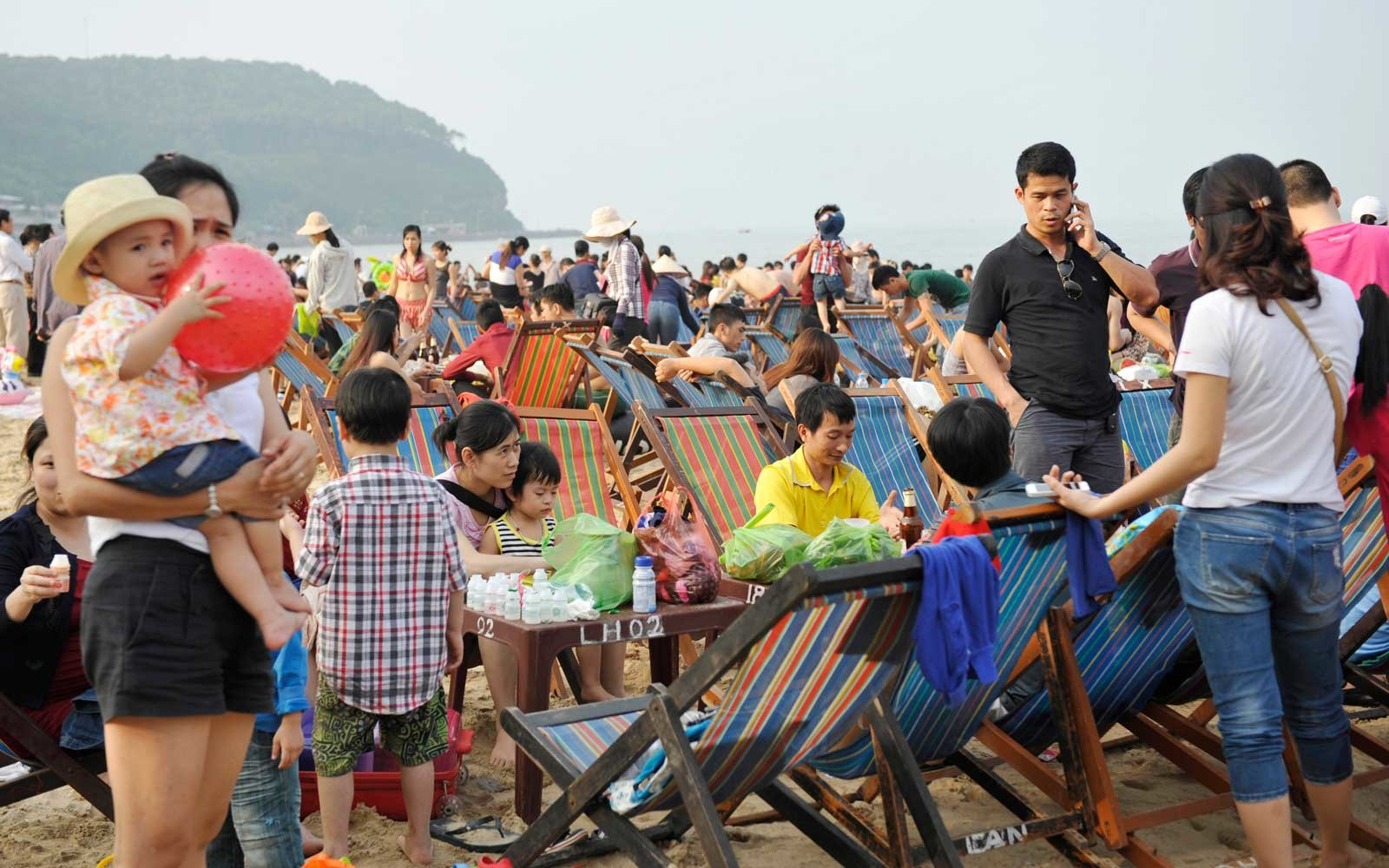 People relaxing on Do Son beach in Vietnam, on May Day