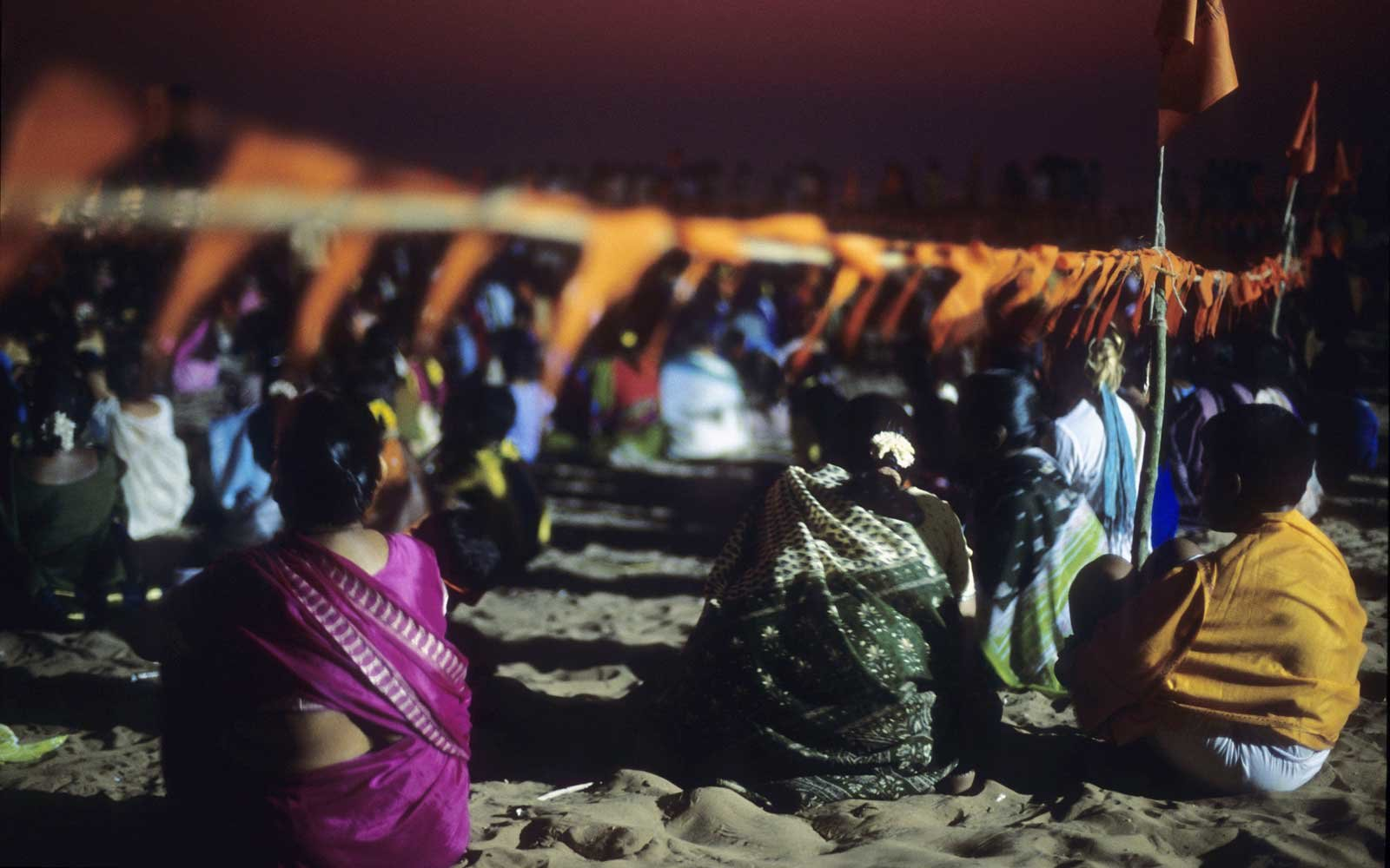 Group of people listening to a guru in Gokarna beach, Karnataka, India.