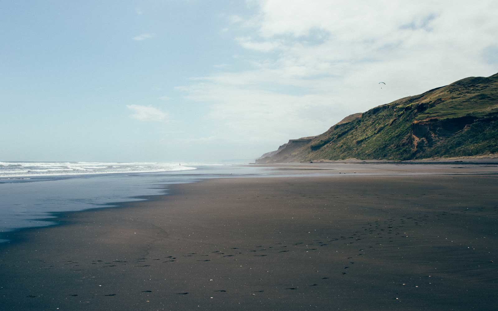 A view on the empty black sand Karioitahi Beach close to Auckland, New Zealand.