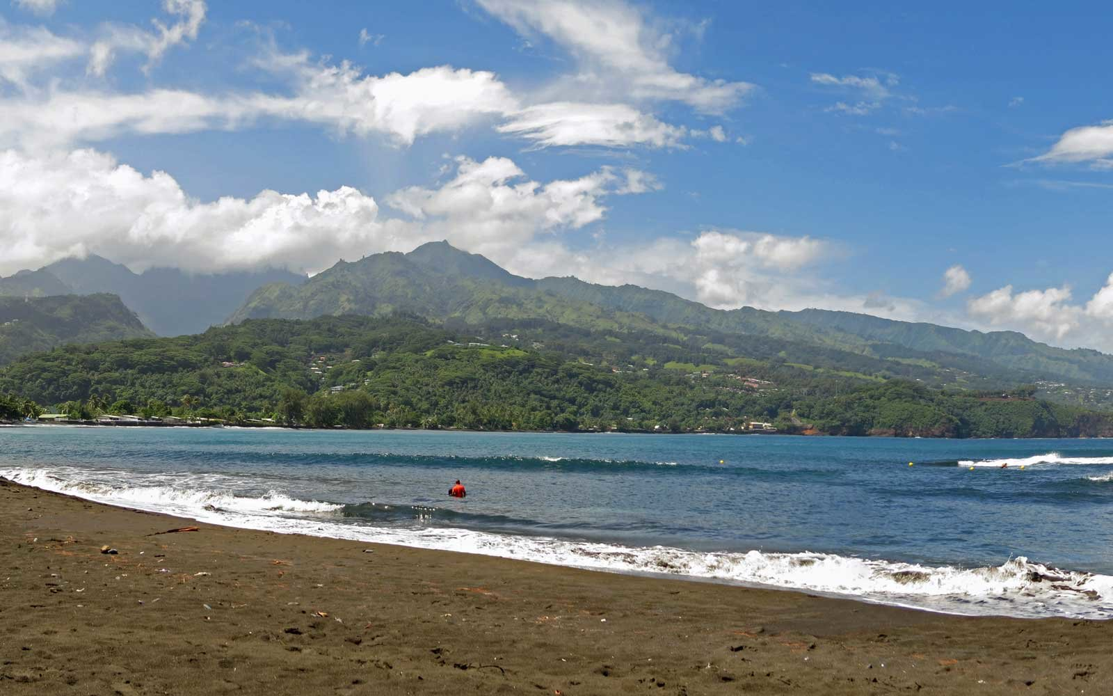 A panoramic view of the black sand beach at historic Point Venus on Tahiti, now a public park Both Captain Cook and Captain Bligh visited here in the 1700s.