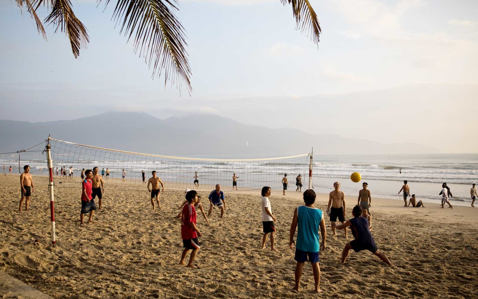 People play volleyball at My Khe Beach in Da Nang, Vietnam,
