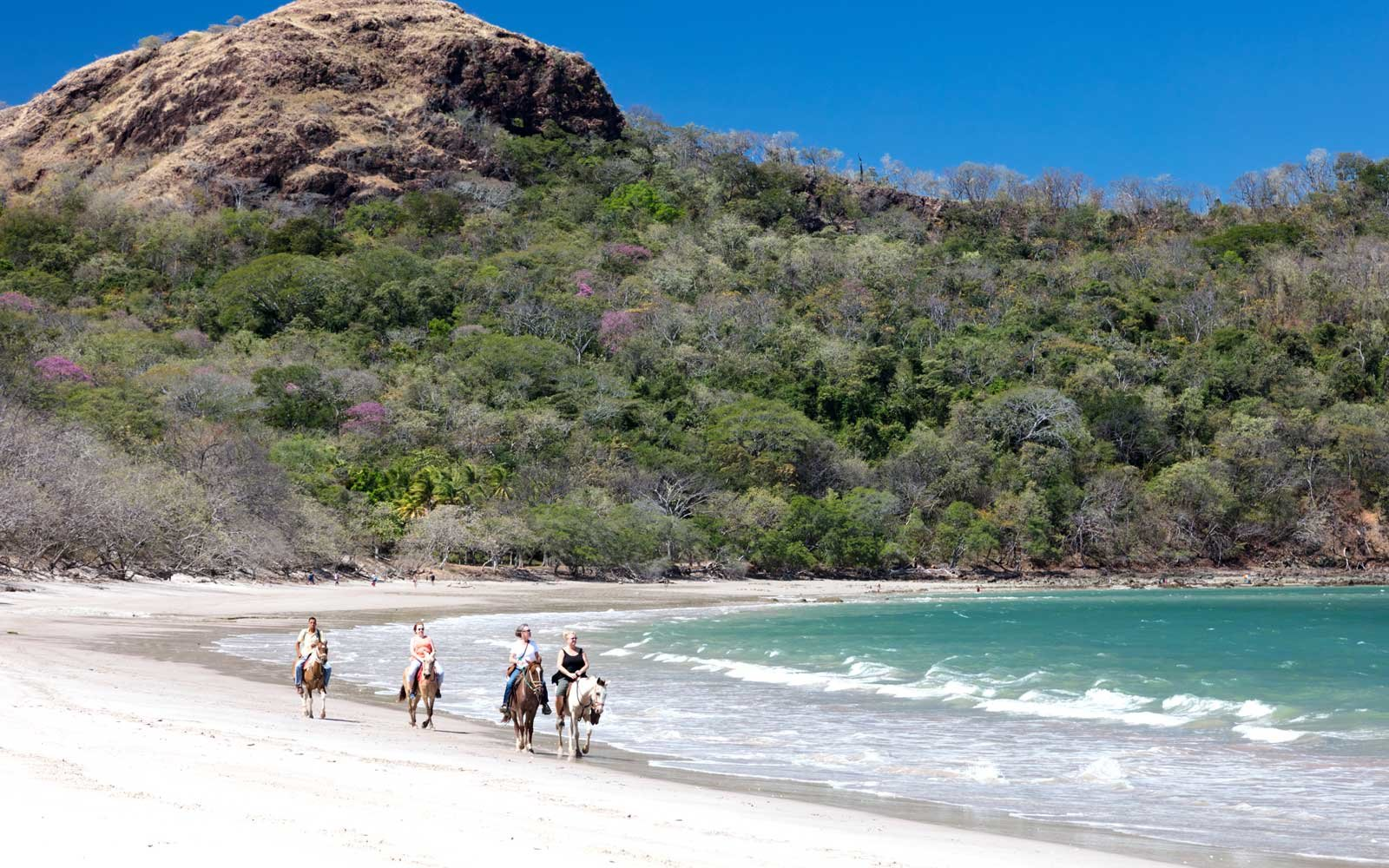 Horseback riding on Playa Conchal in the northern part of Nicoya Peninsula, Costa Rica