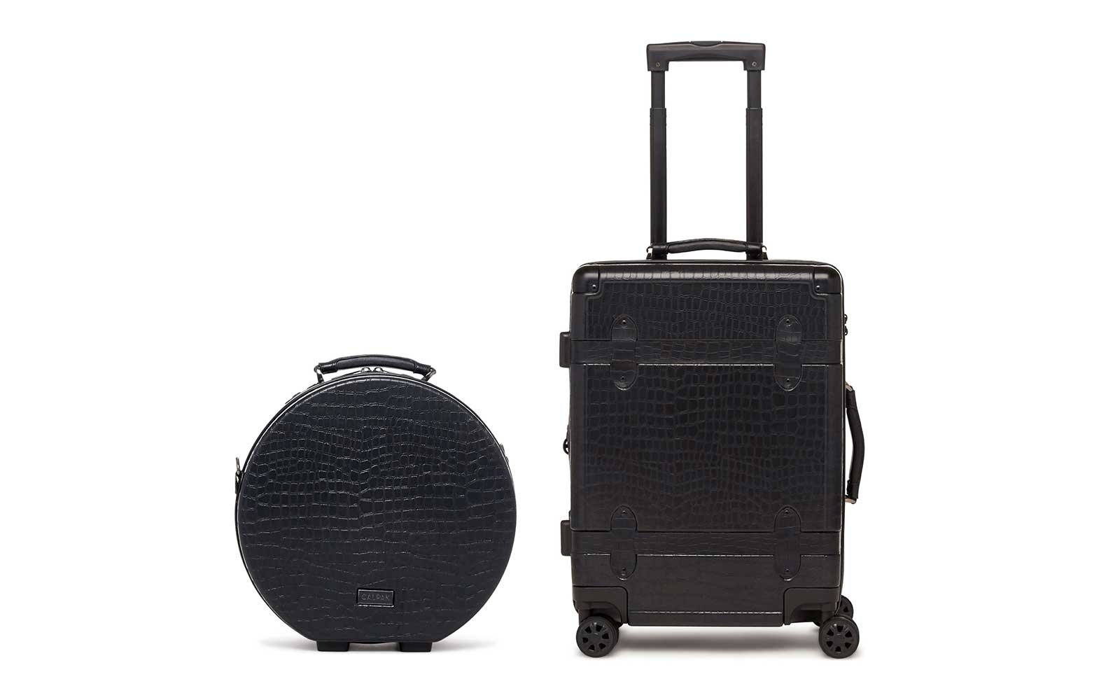 Calkpak rolling trunk and suitcase