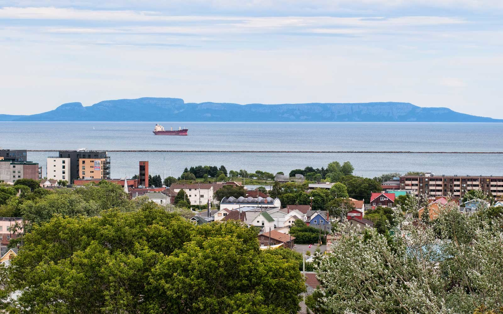 View of downtown Thunber Bay Ontario, Canada north ward and harbour from Hillcrest Park, with Sleeping Giant in background